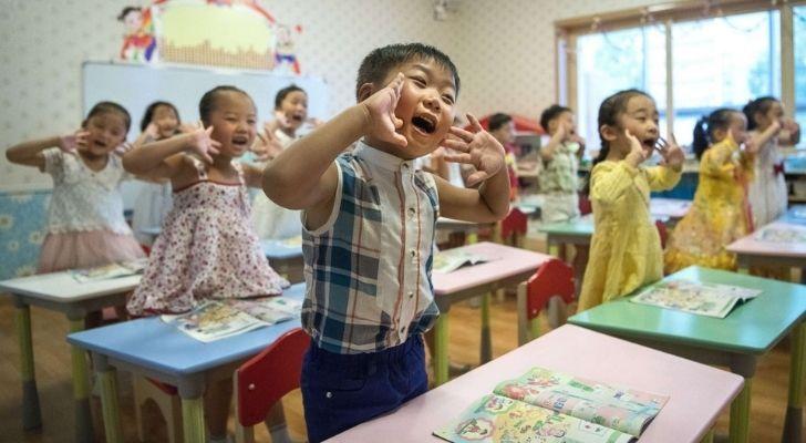 Children in North Korea at school looking happy