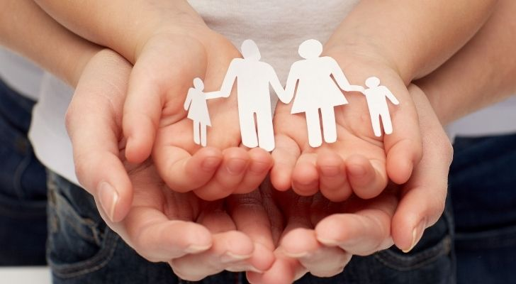 A childs hands in the hands of a grown up