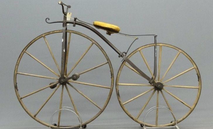 A golden boneshaker bicycle