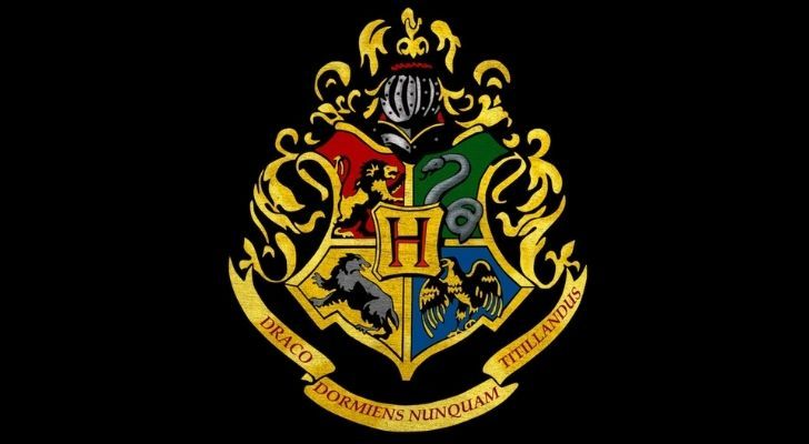 The Hogwarts seal with the motto written below it