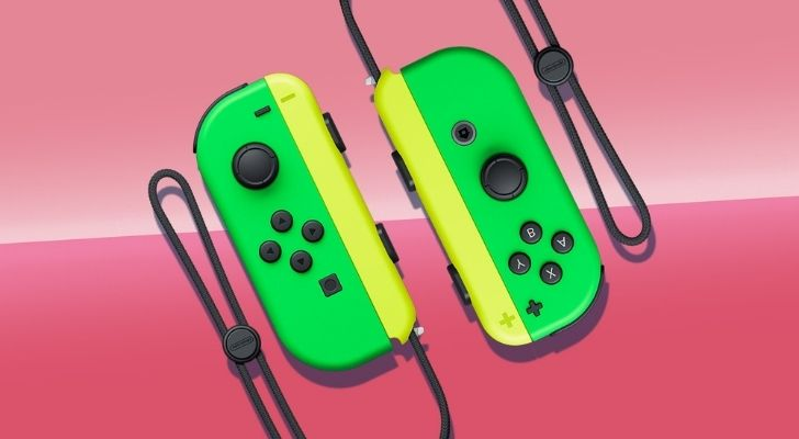 Two green and yellow Switch controllers