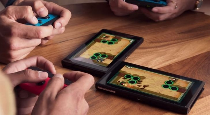 People playing the Switch on different screens connected together