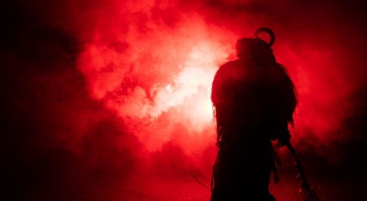 The silhouette of Satan among blood red mist