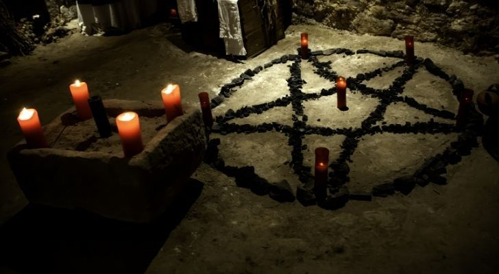 The satanic symbol and candles