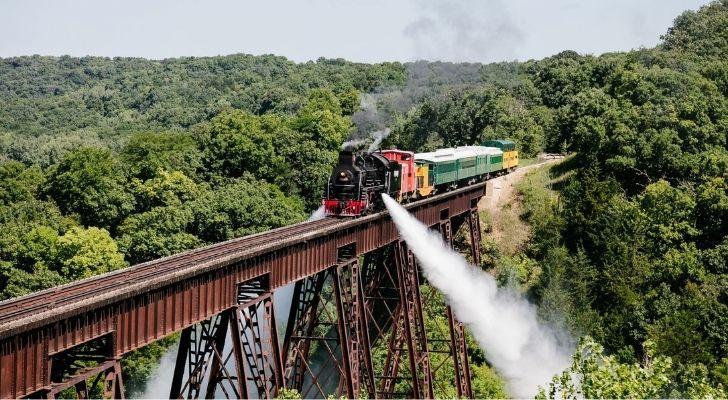 A steam train crossing a bridge in Iowa