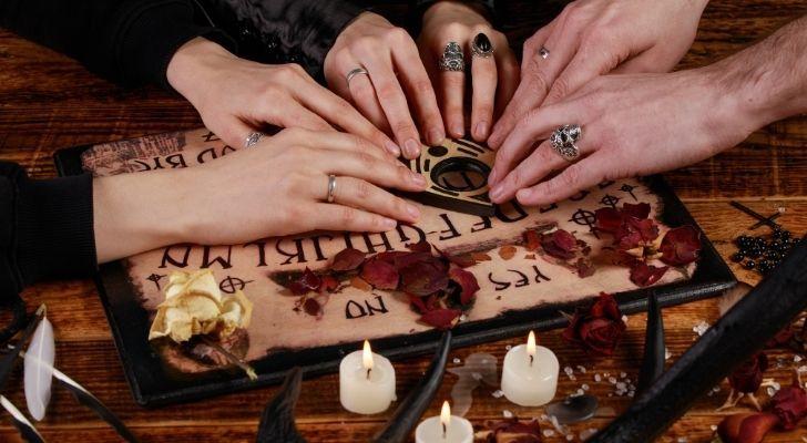 People playing a Ouija board