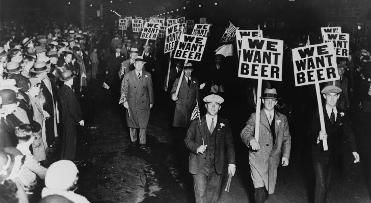 """Protestors holding pickets saying they """"want beer"""""""