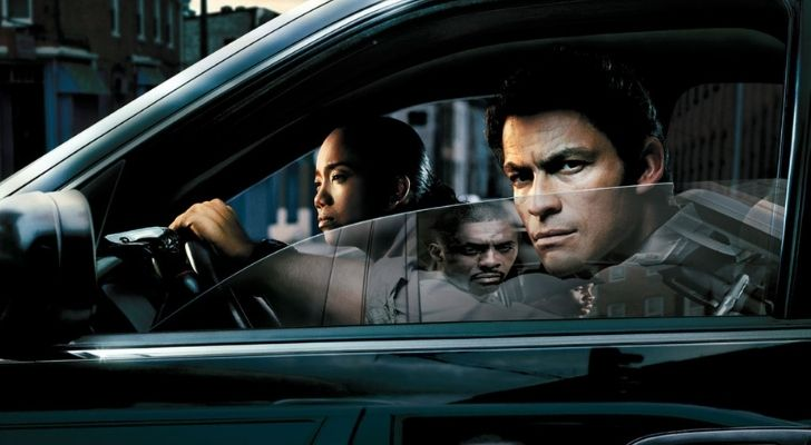 Characters from The Wire series in a car