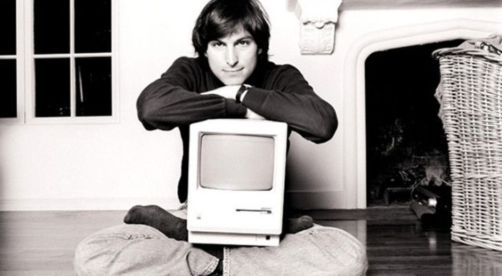 Steve Jobs with an Apple computer on his lap