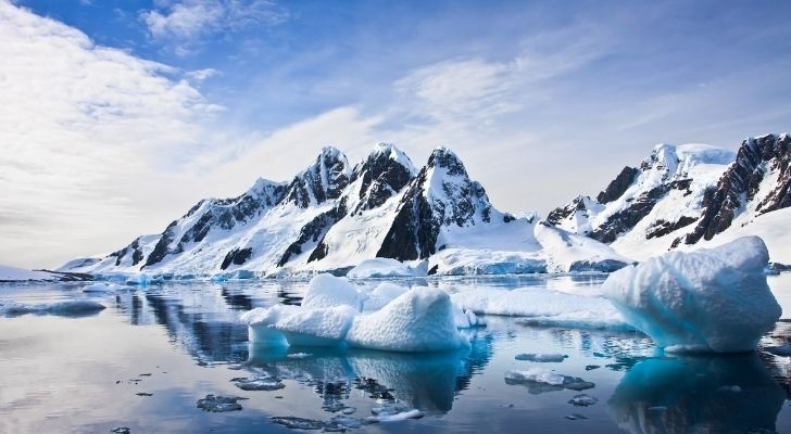 Antarctica landscape of snowy mountains and icebergs