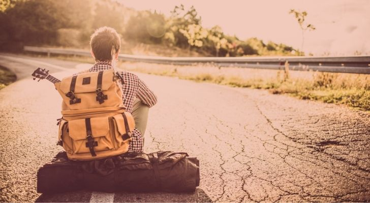 A backpacker waiting for a ride