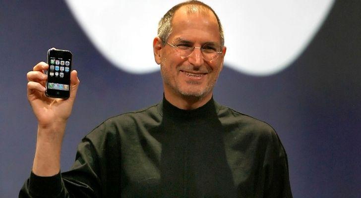 Steve Jobs presenting an iPhone