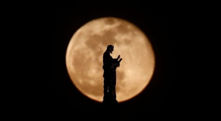 A Catholic statue with the moon behind