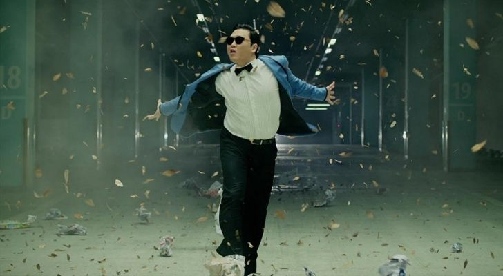 Pay dancing in a suit wearing sunglasses