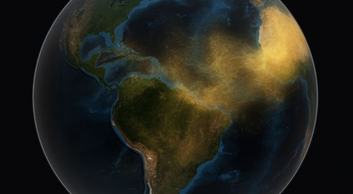 A map of earth showing sand sweeping across the seas from the Sahara to the Amazon Rainforest