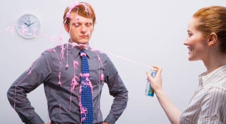 Someone being squirted with silly string