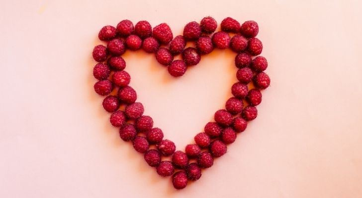 Cranberries arranged into the shape of a heart
