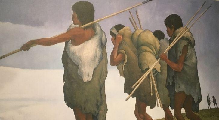 Three Paleo-Indians walking