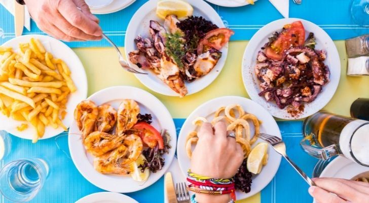 People eating shellfish at a dining table