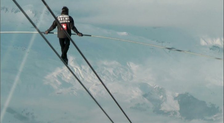 Freddy Rock walking a zip line that's incredibly high