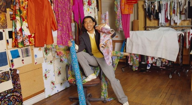 Kenzo Takada in a studio full of fabrics